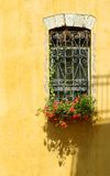 Window on a yellow wall. A window with colors on a wall of the ancient house Royalty Free Stock Images
