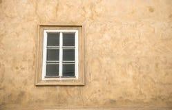 Window on yellow wall Stock Photos