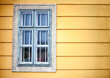 Window On Yellow Wall Royalty Free Stock Image