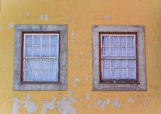 Window on the yellow wall royalty free stock images