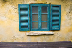 Window on the yellow wall Royalty Free Stock Photography