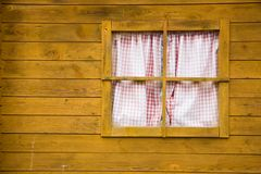 Window on yellow wooden wall Stock Images