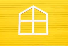 Window on yellow wooden wall. Stock Photo