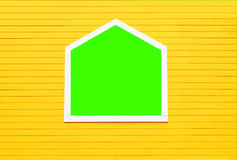 Window on yellow wooden wall on green screen. Royalty Free Stock Photo