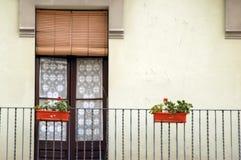 Windowdoor in spain. Balcony with door and flowers in spain Stock Photos