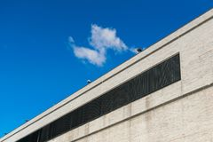 Windowless exterior wall of a tall commercial building in New York City, Harlem, NY, USA stock photo