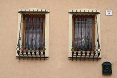 2 Windows из здания с барами Стоковые Фото