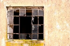 Windows. Discarded ruin with old windows and wall, industrial window in concrete wall Royalty Free Stock Image
