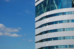 Windows. Office building with a blue sky Royalty Free Stock Photo