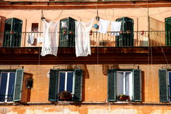 Windows. With drying laundry  in Rome Royalty Free Stock Photography