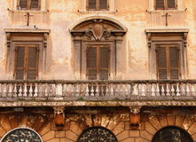Windows. With blinds and Balcony in old building in Rome Stock Photography