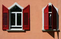Windows. Two windows with red blinds Royalty Free Stock Image