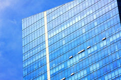 Windows. Modern glass skyscraper against blue sky royalty free stock images