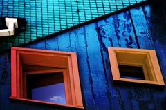 Windows. Two windows on blue painted wood wall Royalty Free Stock Image