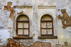 Windows of an abandoned medieval manor. Two windows in the wall of an abandoned medieval manor Stock Photography