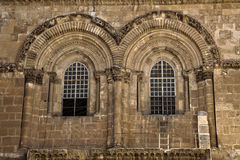 Church of the Holy Sepulchre Facade. The windows above the entrance to the Church of the Holy Sepulchre in the old city of Jerusalem. This is the place where Royalty Free Stock Photography