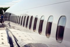 Airplane windows disembarking after arrival at vacation airport Stock Images