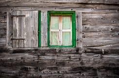 Windows of an ancient alpine lodge stock image
