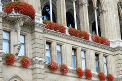 Windows in the ancient architecture of buildings are decorated with flowers.  Royalty Free Stock Photo