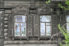 Windows of the ancient wooden house. With blinds Royalty Free Stock Photography