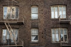 Free Windows And Fire Escapes Tenement Brick Apartment Building Stock Image - 106246391