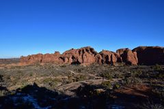 Windows Arch Vista. And Blue Sky - Contrasts in Color in Arches National Park Royalty Free Stock Images
