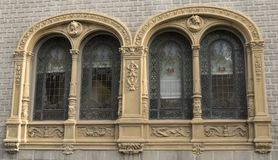 Windows with arches. Continuous windows very decorated with valuable crystals royalty free stock photos