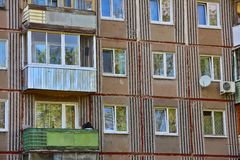 Windows and balconies on facade of prefabricated house Stock Images