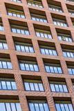 Windows and balconies of the multi-storey building. Background of the windows and balconies of the multi-storey building Royalty Free Stock Photo