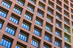 Windows and balconies of the multi-storey building. Background of the windows and balconies of the multi-storey building Royalty Free Stock Photos