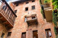 Windows and balconies in the museum courtyard Juliet in Verona Stock Images