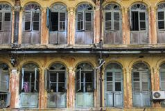 Windows and balconies in the old house royalty free stock photo