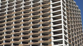 Windows and balconies soaring into blue sky Stock Photo