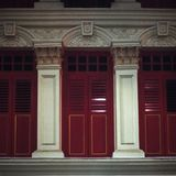 Windows and balconies in typical colonial architecture in Singapore China Town shot with analogue film photography at night. 1 royalty free stock photography
