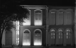 Windows and balconies in typical colonial architecture in Singapore China Town shot in black and white analogue film photography. At night - 2 stock image