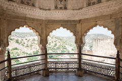 Windows in Balcony. Beautifully architectured balcony inside Amber Fort overlooking the lush green Aravalli hill range in Jaipur, Rajasthan. The artwork Royalty Free Stock Image