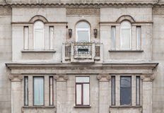 Windows and balcony on facade of apartment building. Several windows in a row and balcony on facade of the urban apartment building front view, St. Petersburg Stock Photography