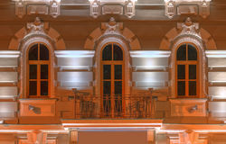 Windows and balcony on night facade of office building Stock Image