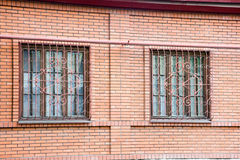 Windows with Bars. Two windows in brick building with decorative bars Stock Image
