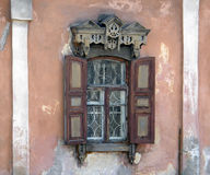The windows with beautiful architraves in old wooden house. Ulan Stock Photo
