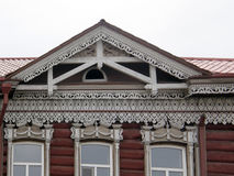The windows with beautiful architraves in old wooden house. Ulan Royalty Free Stock Images