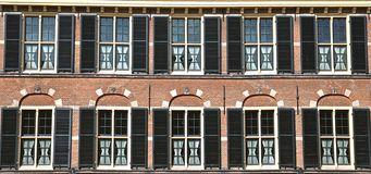 Windows with black shutters royalty free stock photos