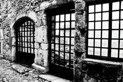 Windows black and white. Wooden frames overlooking a courtyard in Perouges Royalty Free Stock Photos