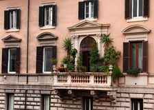Windows. With blinds and Balcony in old building in Rome Stock Photo