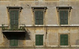 Windows with blinds in Rome. Windows with blinds on an old building at Piazza Farnese in Rome, Italy Stock Photo