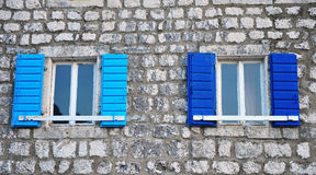 Windows with the blue blinds Stock Photos
