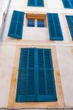 Windows with blue frames Stock Photos