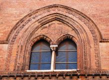 Windows blue. Photo made at the double window of an old building that is located near the main square of Cremona. Cremona is located in Lombardy. The city is Stock Photo