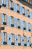 Windows with blue shutters Royalty Free Stock Photo