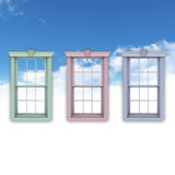 Windows in blue sky. Three colorful windows in midair with blue sky and cloudscape background Royalty Free Stock Photos